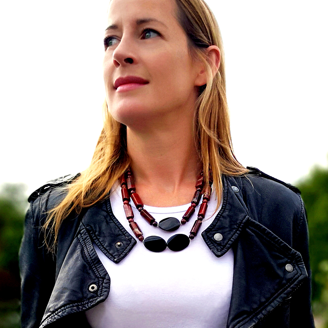 Jane Bardos wearing Mosaico Jewellery Stardust Necklace Rainbow Jasper, Black Agate and Red Apple Jasper Semi-Precious Gemstones